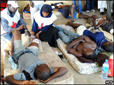 Officials of the Nigerian Red Cross attend to injured victims of the civil unrest at Jos