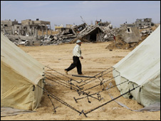 Palestinians in tents near their destroyed homes in Jabaliya