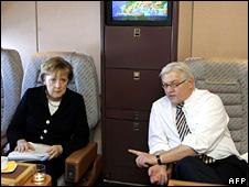 Angela Merkel and Frank-Walter Steinmeier on board a private jet (23 November 2005)