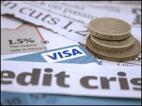 "Money with credit card and newspaper cutting reading ""credit crisis"""