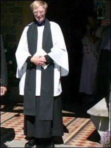 Richard Hart as a vicar outside a church