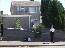 Police outside house in Trimsaran in June 2008