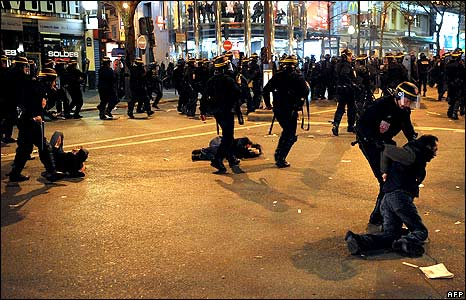Police arresting protesters in Paris.