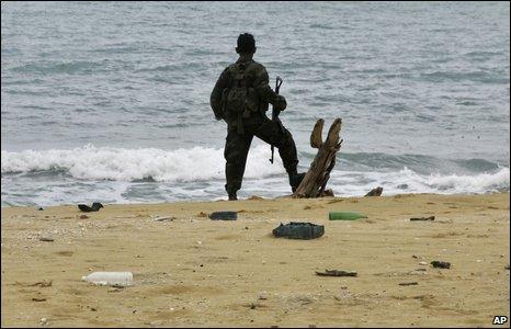 Soldier at a beach at Mullativu