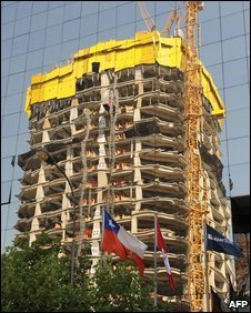 "A building of the ""Costanera Center"" project is reflected on another building in Santiago, on January 29, 2009"