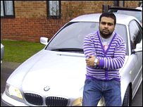 Mohammed standing in front of his car