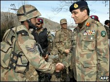 Pakistani army chief Gen Ashfaq Kayani (R) meets a soldier in Swat