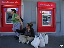 Woman begging asks for money from ATM customer