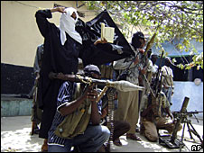Islamist militants pose in a football stadium in Mogadishu, 16 January 2009