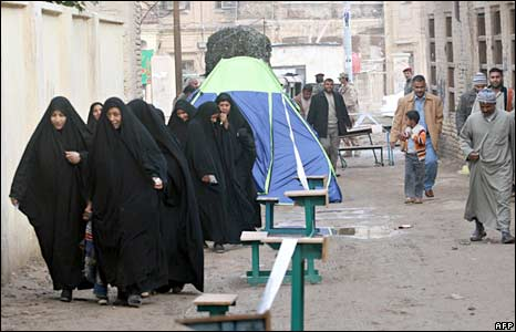 Iraqi women make their way to a polling station in Basra