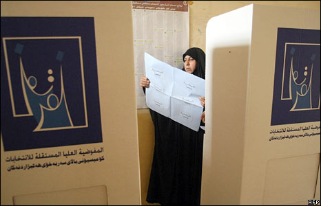 An Iraqi voter at a polling station
