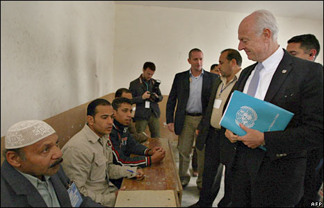 UN High Commission Representative Stephane Demistora visits a polling station in the western city of Ramadi