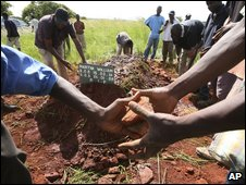 Relatives cover grave of cholera victim - photo 29 January