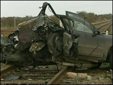 Wreck of a car hit by a train
