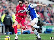 Tugay battles for possession with Blackburn's Vincenzo Grella