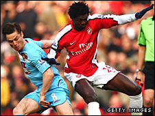 Scott Parker (left) challenge Emmanuel Adebayor