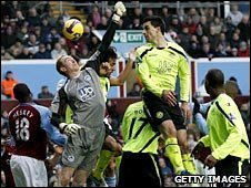 Wigan keeper Chris Kirkland clears his lines