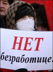 "Russian Communist Party supporter holds a poster reading ""No to unemployment!"" during an anti-government rally in central Moscow"