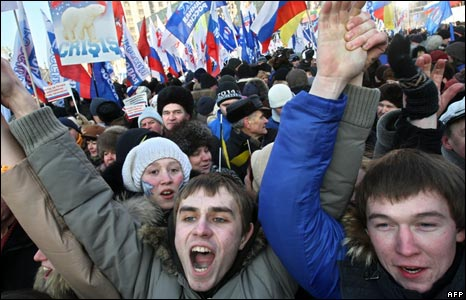 Russian government supporters shout during a pro-government rally in central Moscow