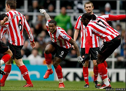 Sunderland striker Djibril Cisse celebrates with his team-mates