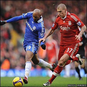 Nicolas Anelka is shadowed by Liverpool's Martin Skrtel