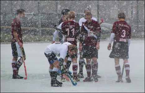 A hockey match in the snow
