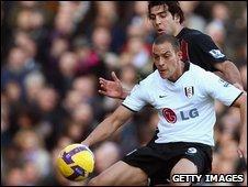 Tal Ben Haim marks Fulham's Bobby Zamora