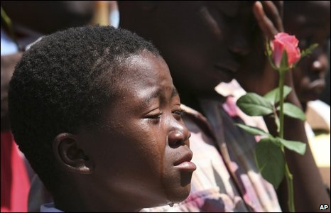 Tatenda Munodavanhu cries at his grandmother Martha William's burial after she died from cholera in Harare, Zimbabwe on 29 January 2009