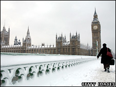 A commuter walks towards the Houses of Parliament in London (2 February 2009)