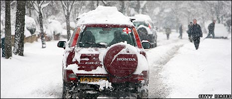 Car makes its way through snow