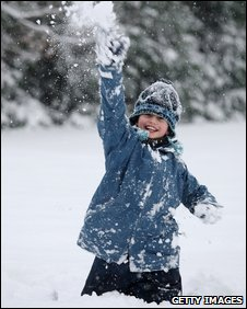A child enjoys the snow in Camberley, Surrey