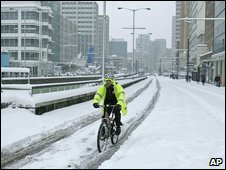 A cyclist on a snow covered road in Croydon, south London