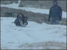 People sledging at the Horseshoe Pass, near Llangollen
