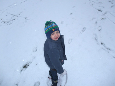 boy plays in snow