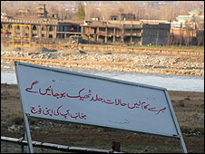 Army sign in Swat urging local people to 'be patient'