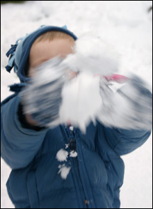 boy throwing snow
