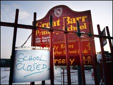 Closed sign outside a school