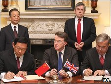 Agreement signing, overseen by Lord Mandelson and witnessed by Wen Jiabao  and Gordon Brown