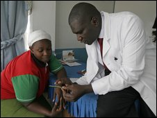 A doctor explains family planning to a woman in Kenya
