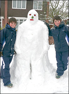 Scott and Cameron with snowman