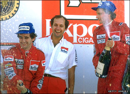 (Left to right) Alain Prost, Ron Dennis and Niki Lauda celebrate a one-two at the Portuguese Grand Prix
