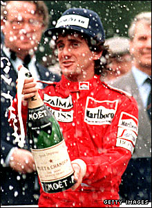 Alain Prost celebrates winning the world title in 1985