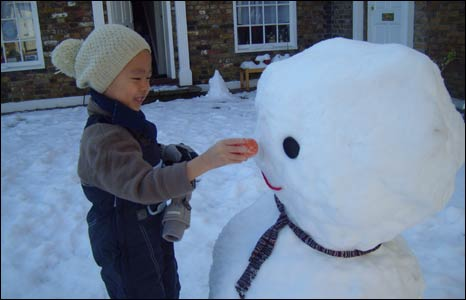 Jan Ta fixing the nose of a snowman