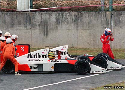 Alain Prost walks away after crashing with Ayrton Senna at the 1989 Japanese Grand Prix