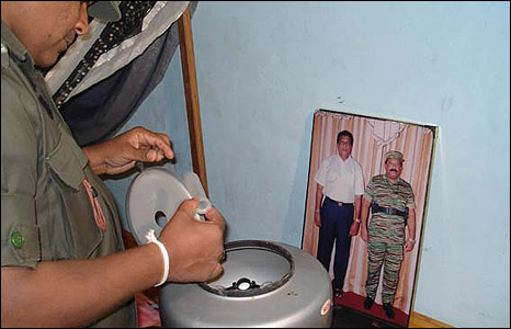 Sri Lankan soldier with a medical centrifuge found in the complex