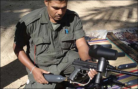 Sri Lankan soldier with a paint gun