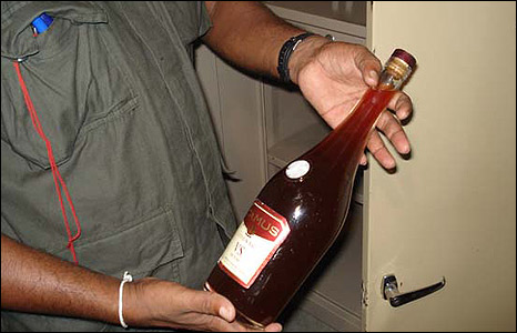 Soldier with bottle of alcohol