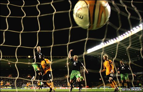 The ball lands in the Norwich City goal