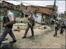 Police patrol Paraisopolis slum in Sao Paulo, 3 February 2009