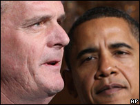 Judd Gregg y Barack Obama